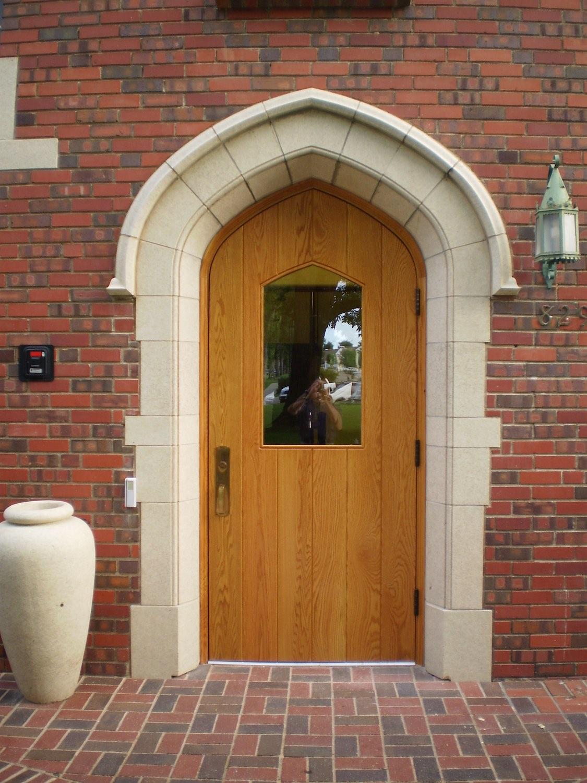Wooden door in brick building